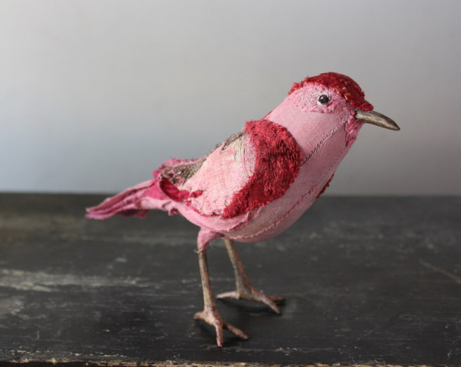 crimson and-pink songbird