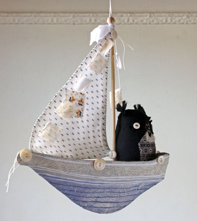blue paper mache ship and owl