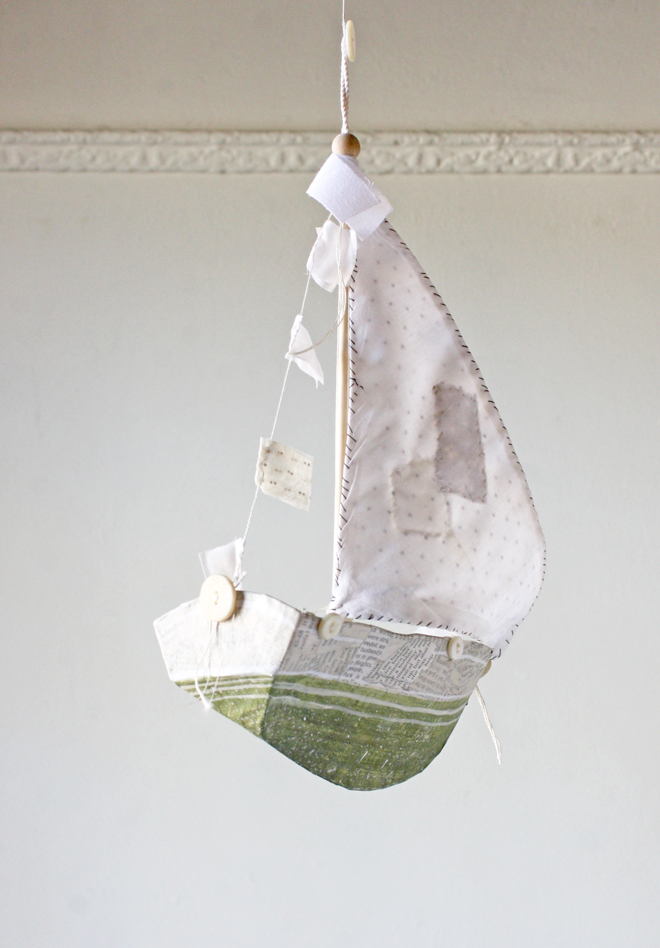 green paper mache boat