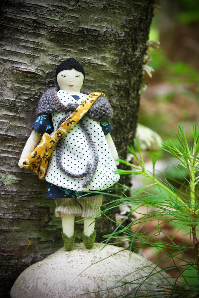 tiny rag doll in the forest