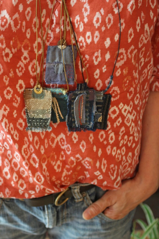 colorful stitched pendants worn with an ikat print smock