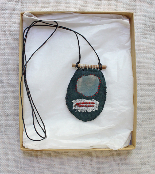 hand stitched textile amulet necklace
