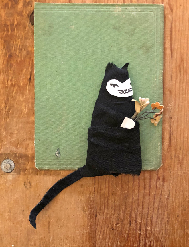 cardboard, paper and fabric cat figure experiment