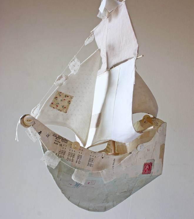 paper mache ship with ivory and blue hull