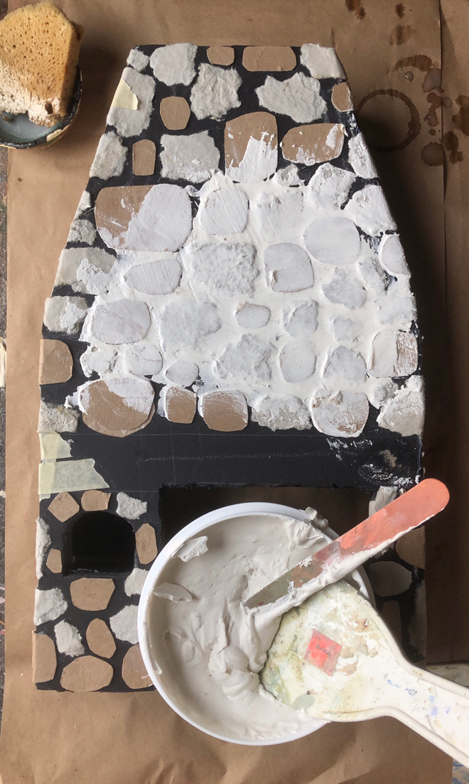 coat the surface with spackle