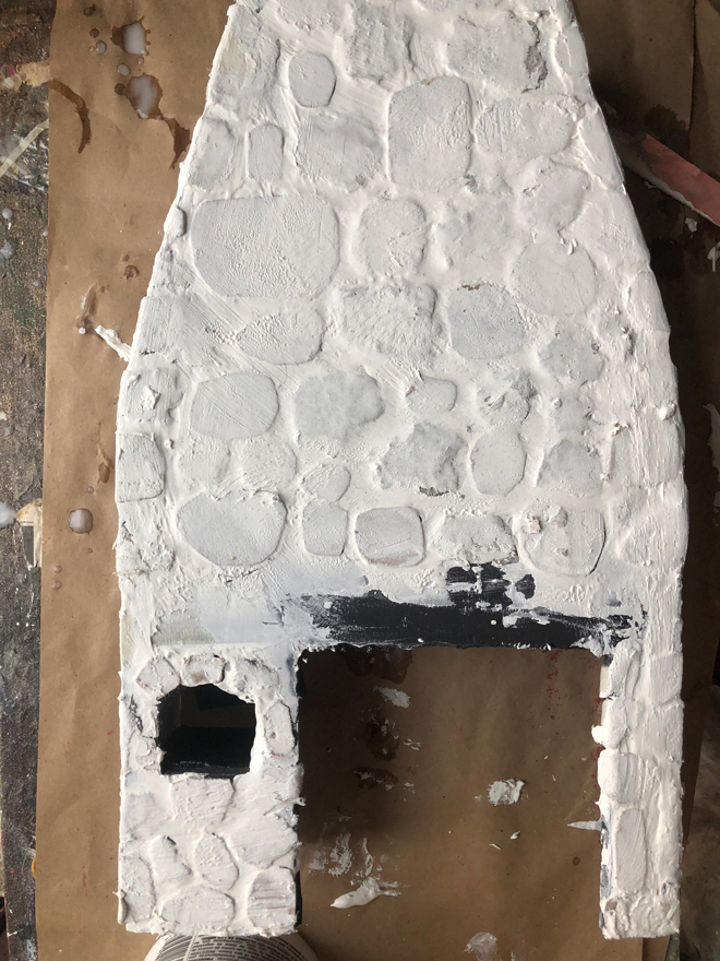 miniature hearth covered in spackle