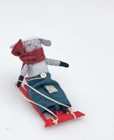 doll on a popsicle stick sled