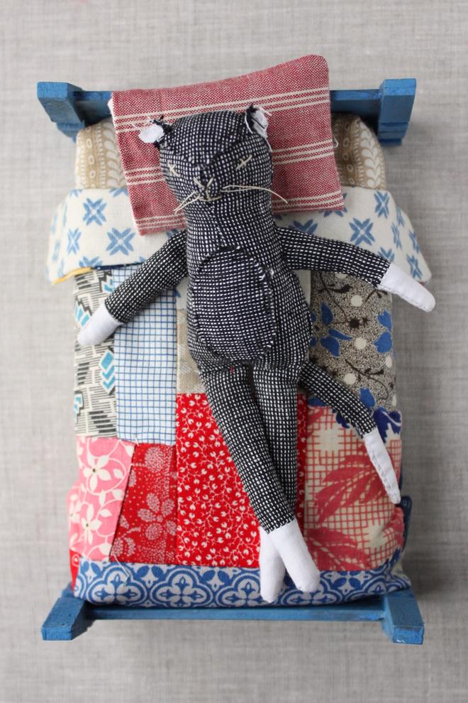 mr. socks in a sweet doll bed