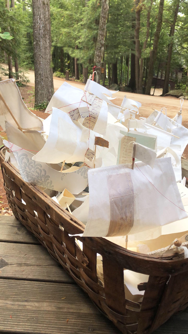 paper boats in a basket