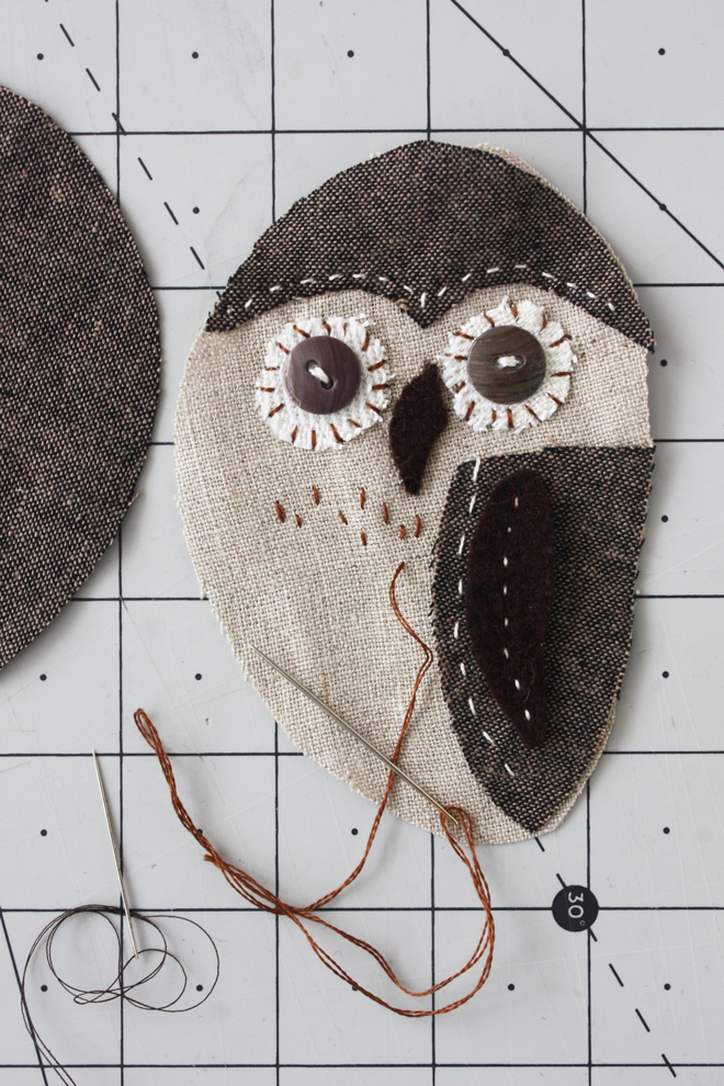 adding stitches with brown embroidery thread