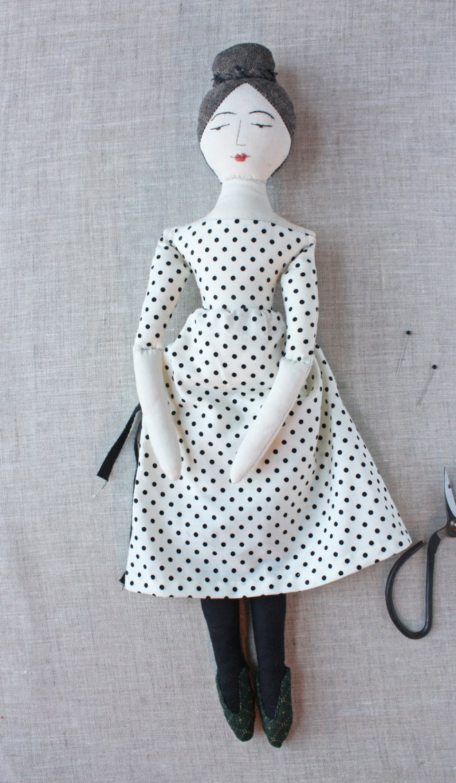 elegant rag doll in a black and ivory polka dot dress