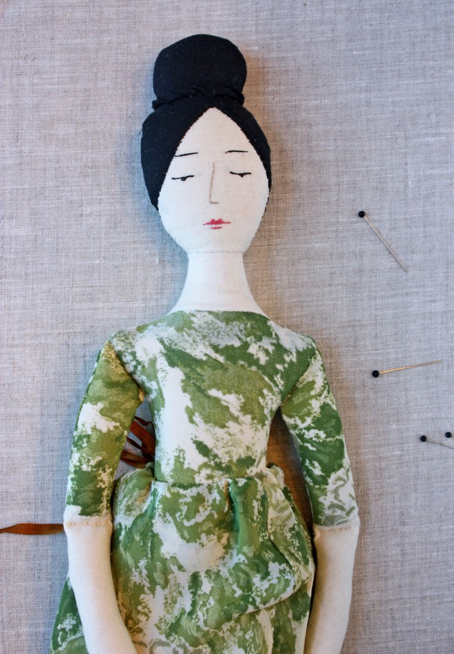 rag doll in green dress and slippers