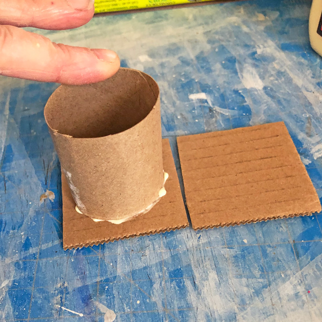 gluing the tube to one cardboard square