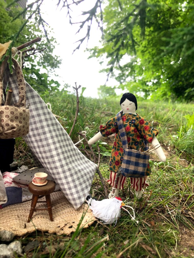 miniature tent, campsite and doll with miniature dishes and a paper chicken