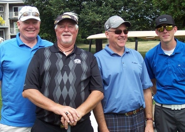 Teams enjoying the Annual Anoka Area Chamber Golf Tournament