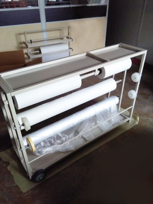 Moveable masking paper dispenser is 3 shelve and with 3