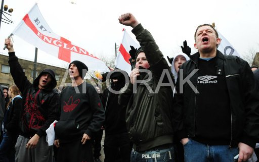 EDLers in Bolton, giving Nazi salute