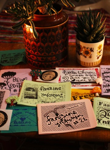 spread of zines on table