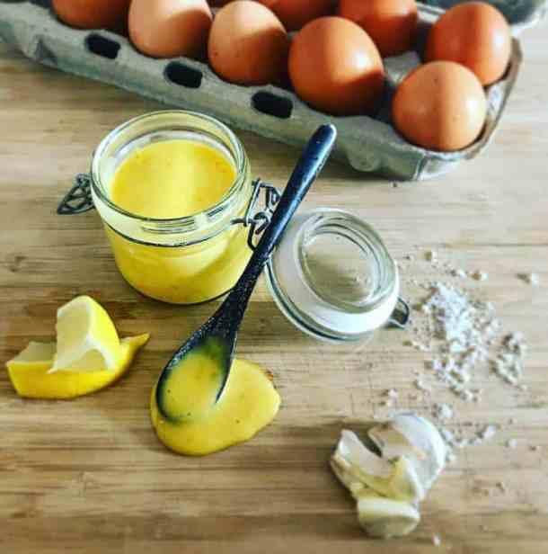 Aioli, eggs, garlic & lemon on chopping board
