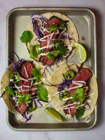 3 steak tacos - carne asada style on a tray