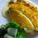 fish pie and salad on a plate