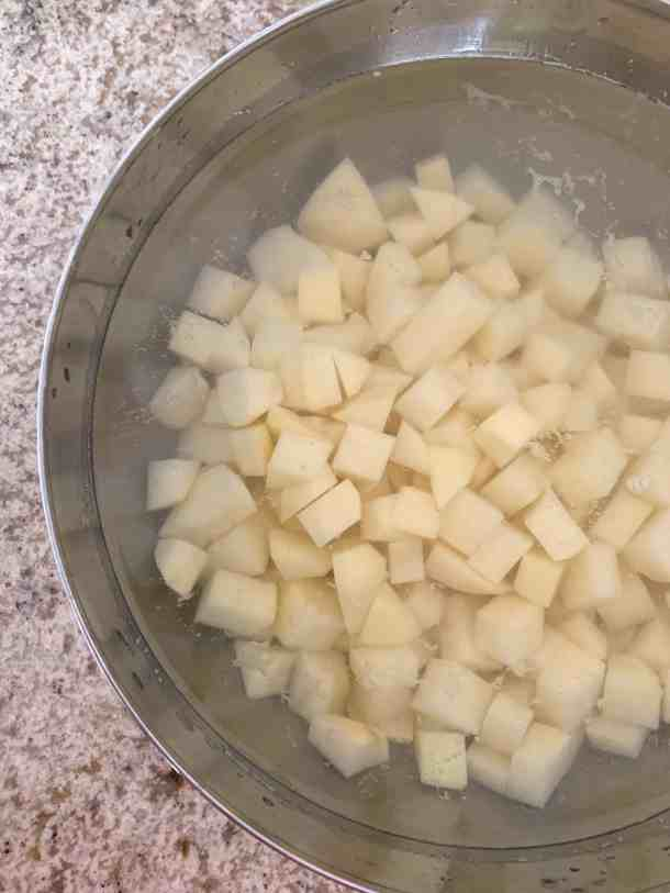 Peeled potatoes in water