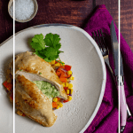 jalapeno popper stuffed chicken & corn hash on a plate, pink napkin, laguiole steak knife and bottle of gomersal wine