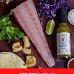 snapper, tortillas, pineapple, spices and red cabbage on a table