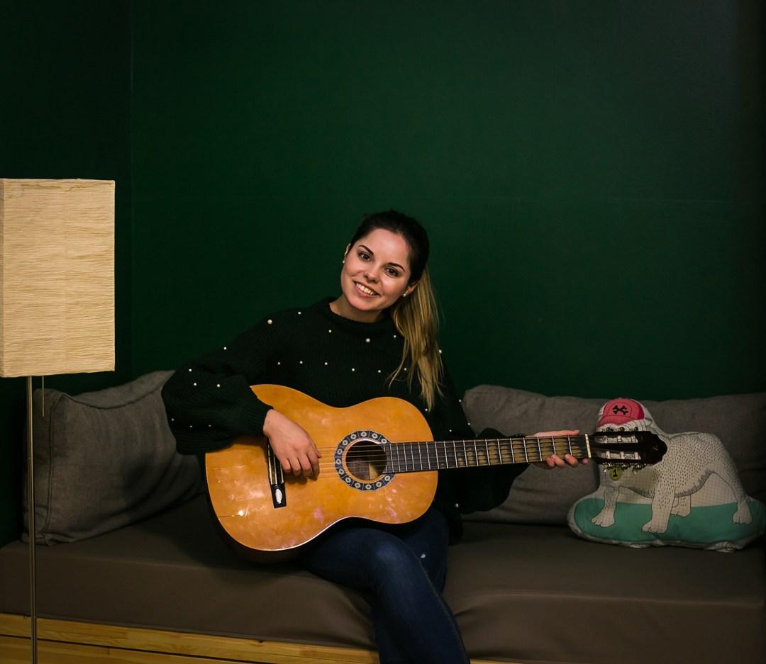 playing guitar maverick lodge hostel budapest