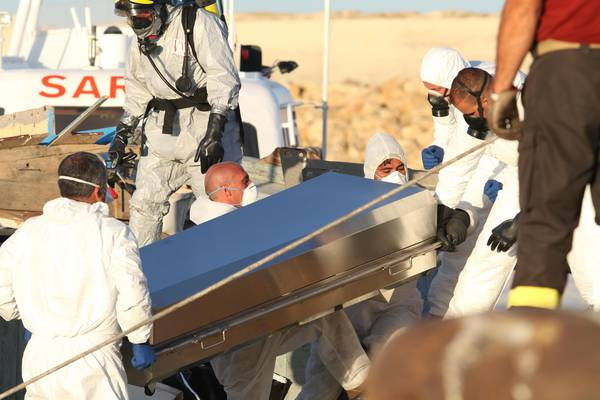 Bodies of migrants taken out of the fishing boat in Pozzallo