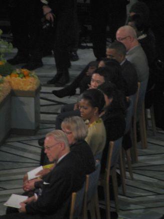 Mrs. Michelle Obama (center)