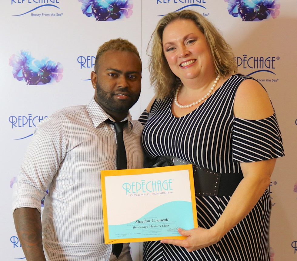 Sheldon Cornwall, left, of Gala Banana Studio is presented with his certificate from Repechage International Educator Delaine West at a recent Masters Class at the Hyatt Regency, Port-of-Spain.