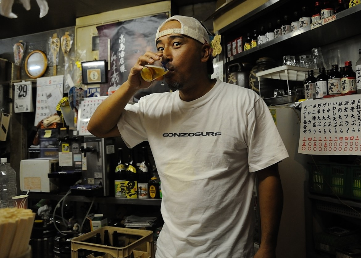 Photograph of a man drinking