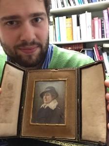 Dukes auctioneer Tim Medhurst with Elsie Bowerman portrait