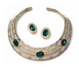 """Collar and earrings set designed by Les Bernard with """"emeralds and diamonds"""" in gold tome metal"""