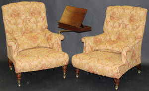 A Howard button back armchair with mahogany reading slope