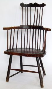 A stickback elbow chair