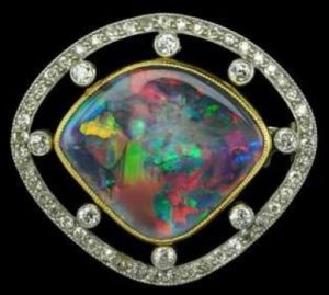 An early 20th century black opal and diamond brooch