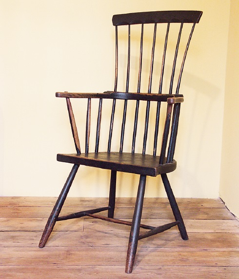 A light and airy comb-back made from ash timbers of the smallest dimension I can remember seeing. If the parts were laid out on a bench you would never imagine that they were sufficient to make a chair! But it is strong, and comfortable. The painted finish is untouched, just worn away in the right places. Carmarthenshire, c. 1780-1820. Writer's collection