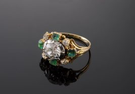 A Georgian diamond and emerald cluster ring