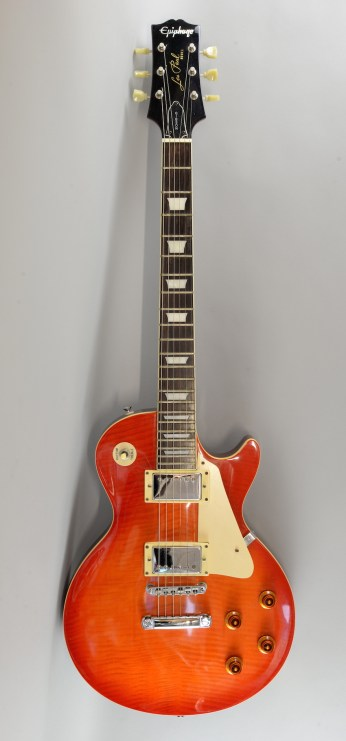 An Epiphone Gibson Les Paul electric guitar carries a pre-sale estimate of between £200 and £400
