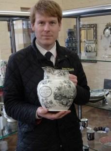 Chris Large of Peter Wilson auctioneers with Haslington jug