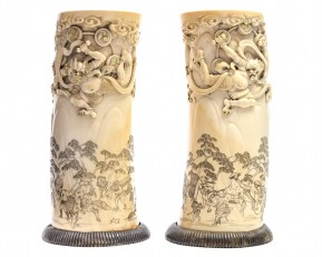 A pair of antique ivory tusk vases