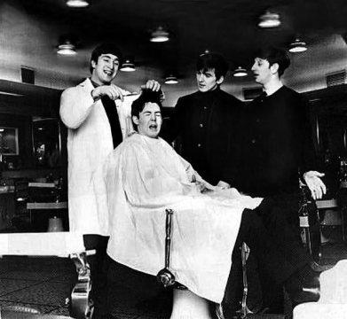 The Beatles get their hair cut