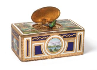 An antique • A Gilt-Metal and Enamel Singing Bird Box – Sold for £2,400