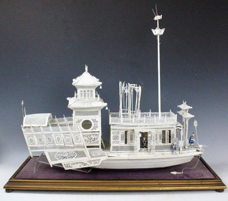 A carved ivory model of a travelling river boat sold for £2,300.