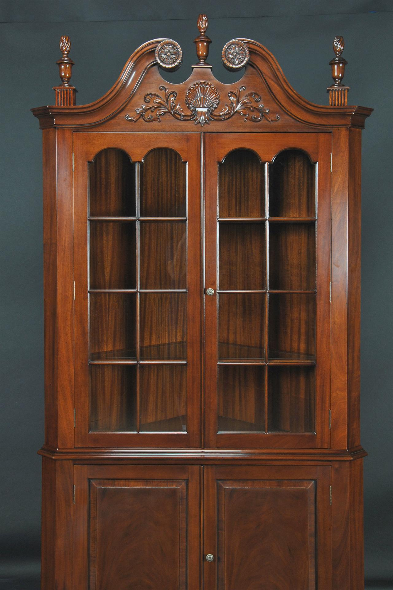Colonial Style Corner Cabinet With Carved Arch