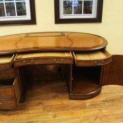 Executive Brown Leather Office Chairs White Round Table And Walnut Top Kidney Desk With Hidden Monitor Lift