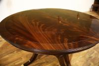 High End Round dining table with 3 leaves sits 12