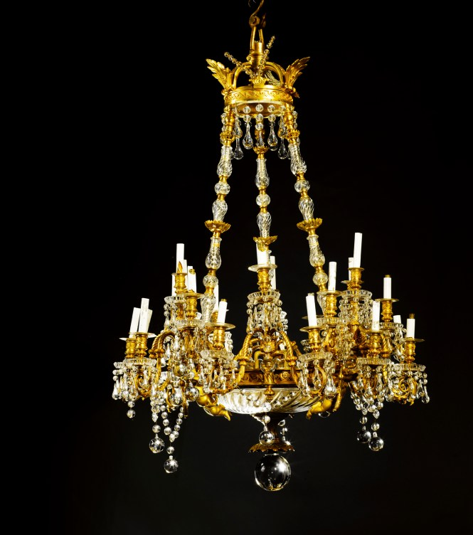 Maison Baccarat A Large Two Tone Burnished Gilt Bronze And Crystal Twenty Seven Light Chandelier Second Half 19th Century Hung From Coronet With Three